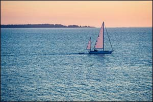 sailboat at sunrise